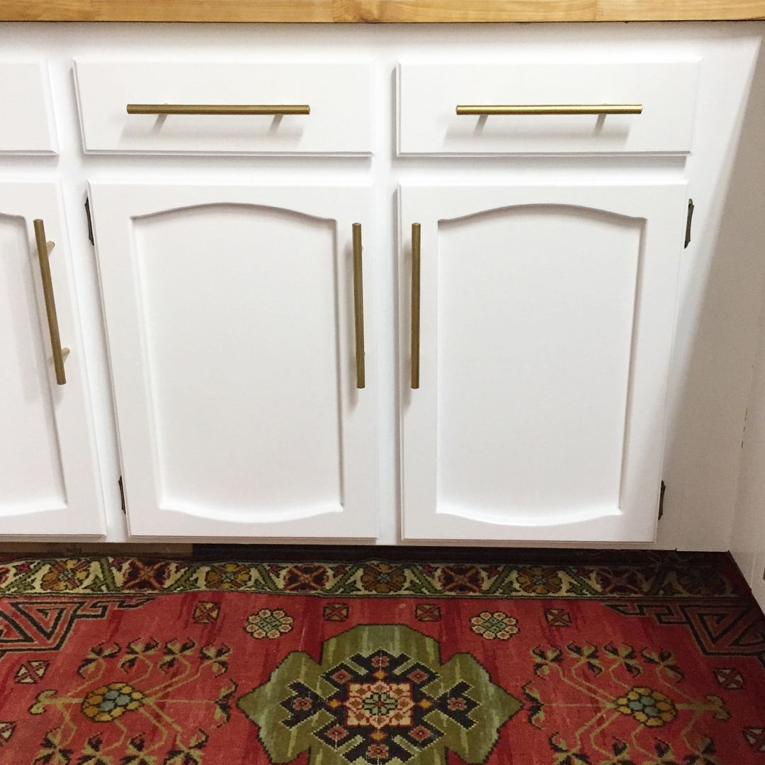 Spray paint for kitchen cupboards  Painted white kitchen cabinets REVEAL  Before and after  Left