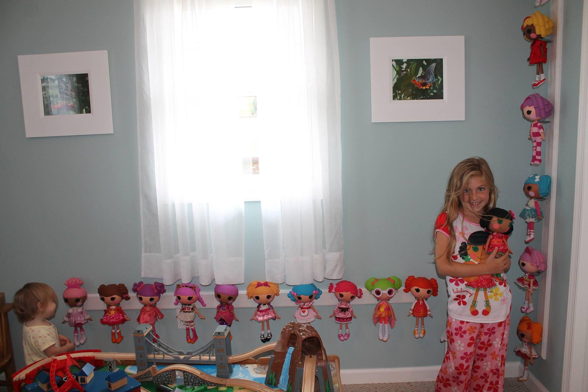 C-shape Hook Holding Dolls To Board