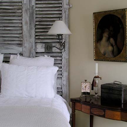 Shutter headboard with the wall sconce attached?!? great idea!