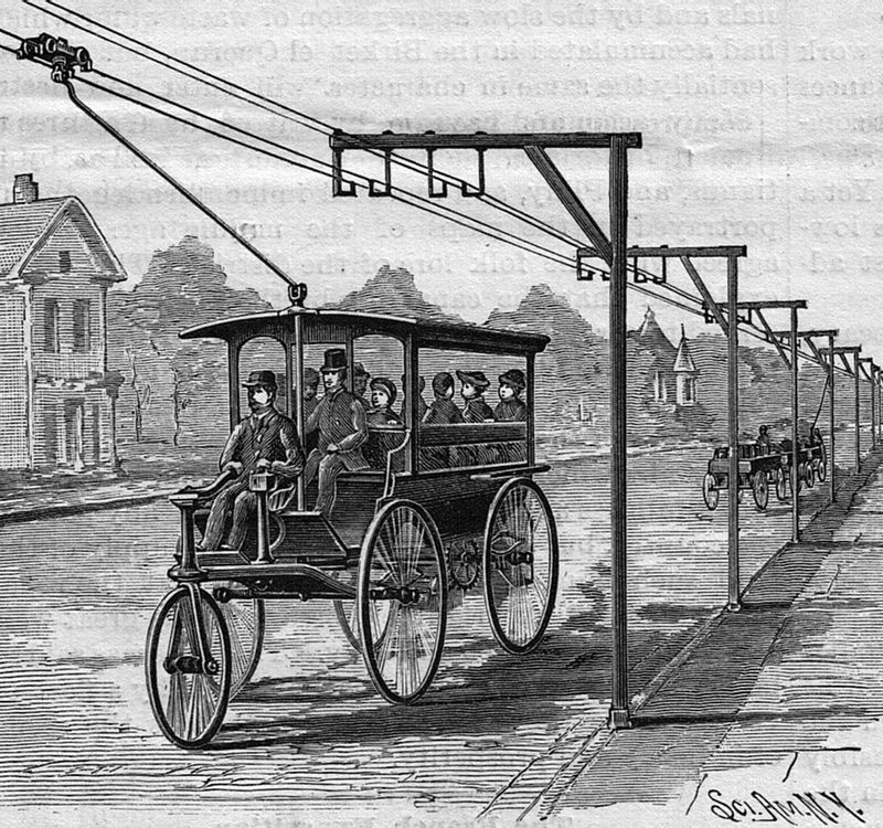 This Overhead Wire Electric Car Thing A Ma Jig Was Way Ahead Of Its Time Electric Cars Advanced Driving Car