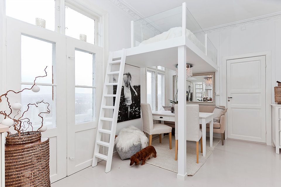 This loft bed with glass railings lets the light through ...