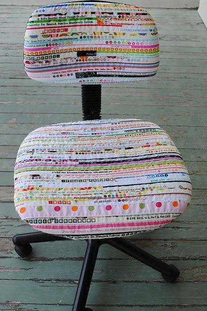Sewing chair covered with selvages. Great way to carry the sewing theme onto your chair, and brighten up a dull office chair for your craft room!