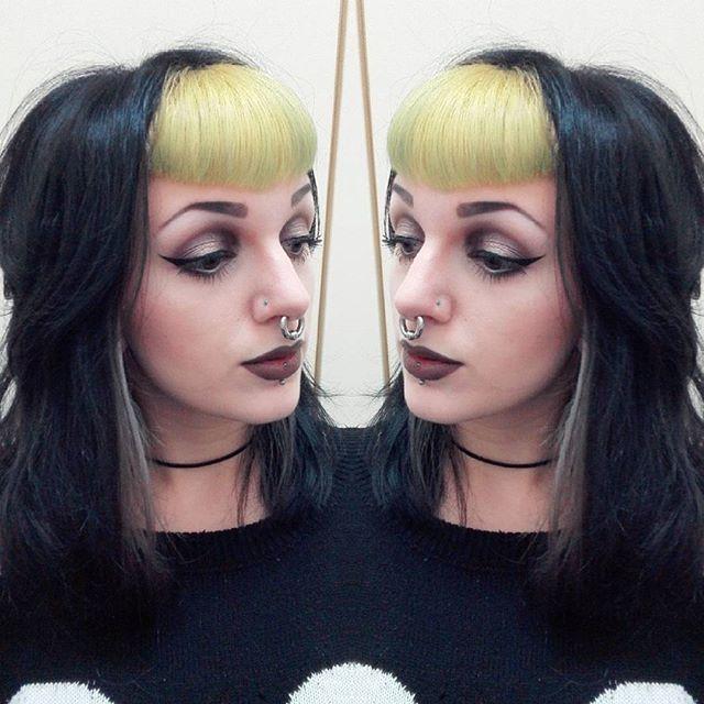 Black hair blonde bangs woman