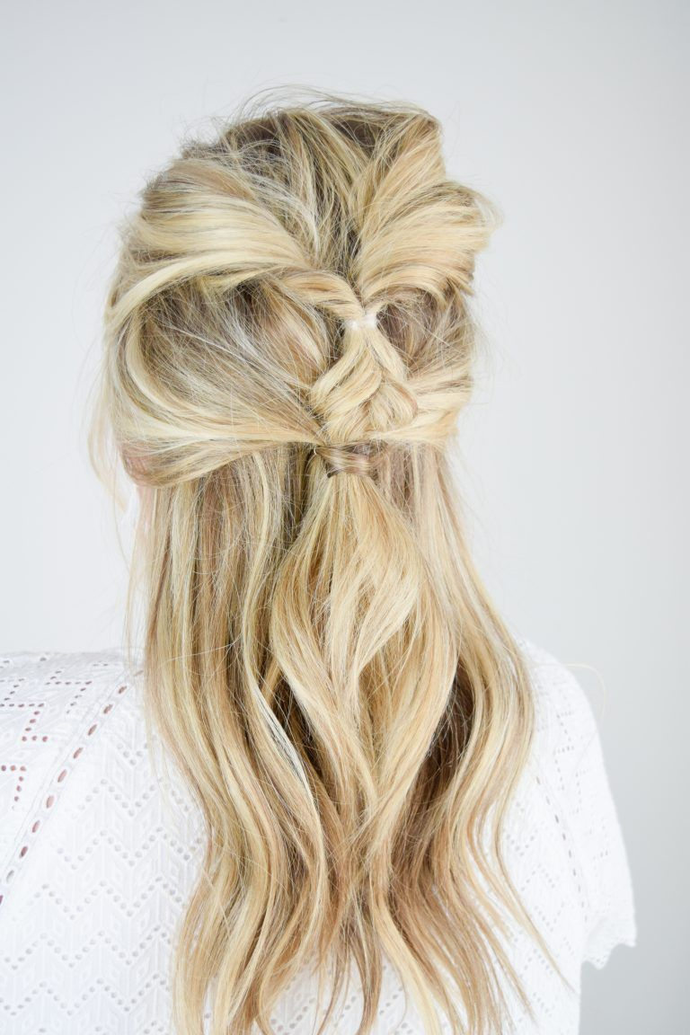 Cute hairstyle with twists and loose curls and waves for a casual