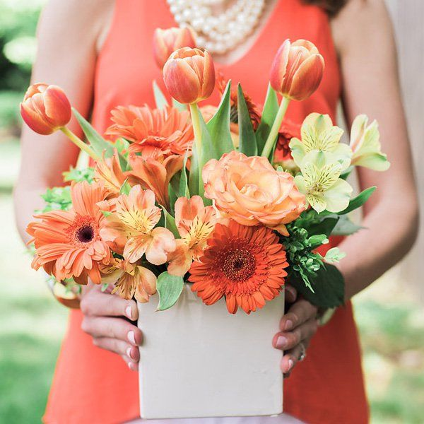 """When in doubt (and in lily-related sticker shock), """"Try a tulip instead!"""" says Greenoe. """"They come in so many different shades, so you're sure to find one that fits your wedding colors."""""""