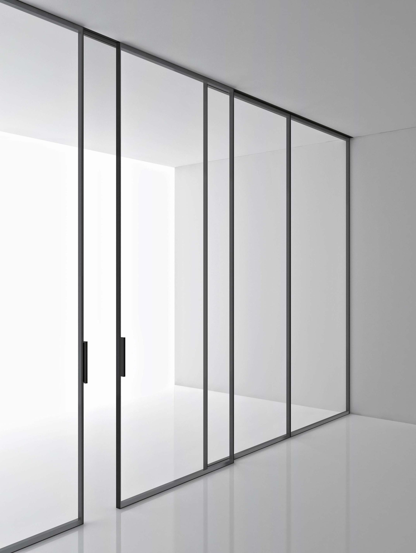 Porta Scorrevole Su Muro Portante sistema di porte scorrevoli o fisse da pavimento a soffitto
