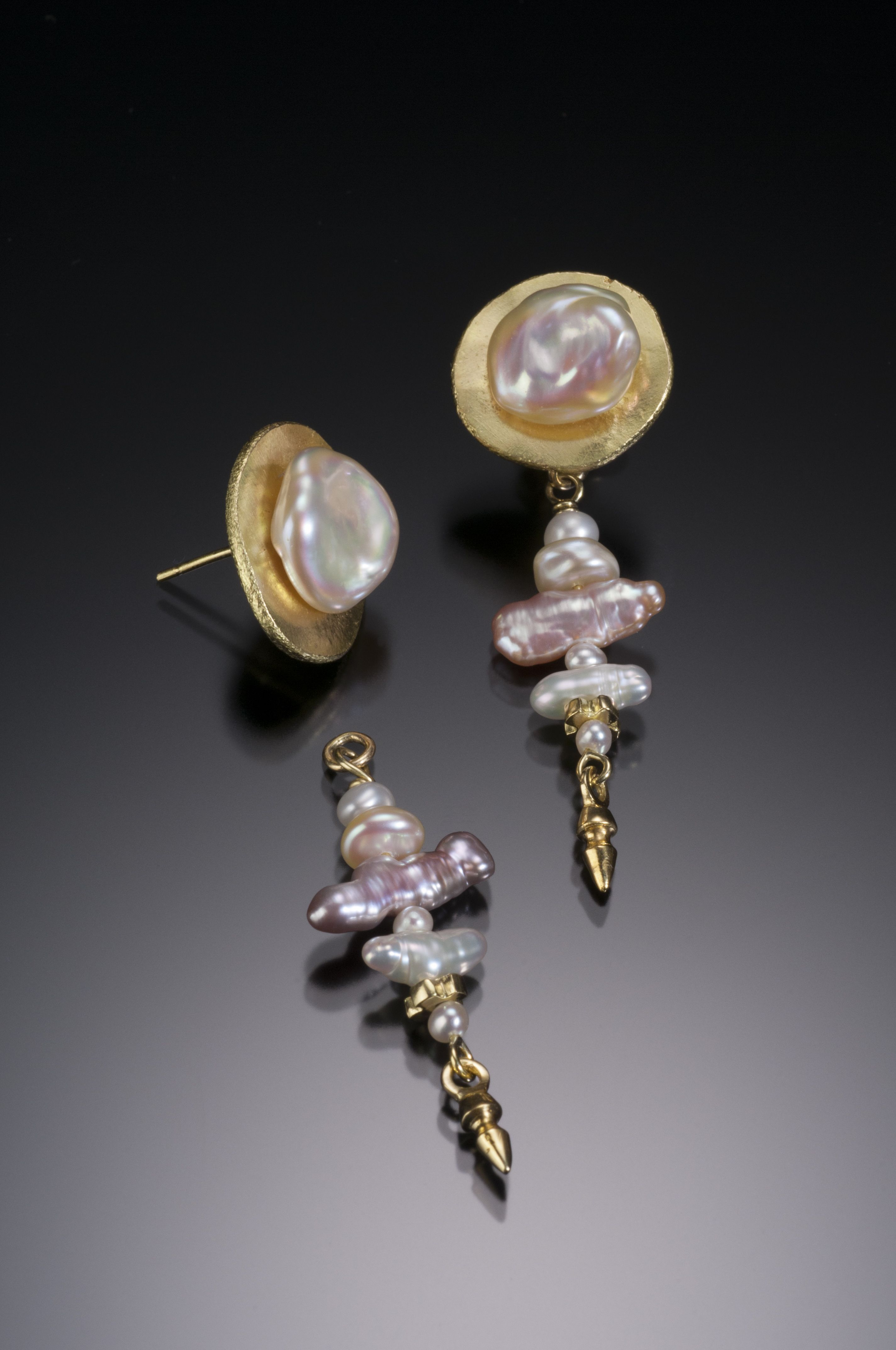 Just like you, one of a kind, 18K gold and fresh water pearls for the gal on the go!