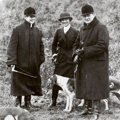 On right, Winston Churchill (1874 - 1965) accompanied by his son Randolph (1911 - 1968) and Mlle Chanel (1883 - 1971) at a meet of the Duke ...