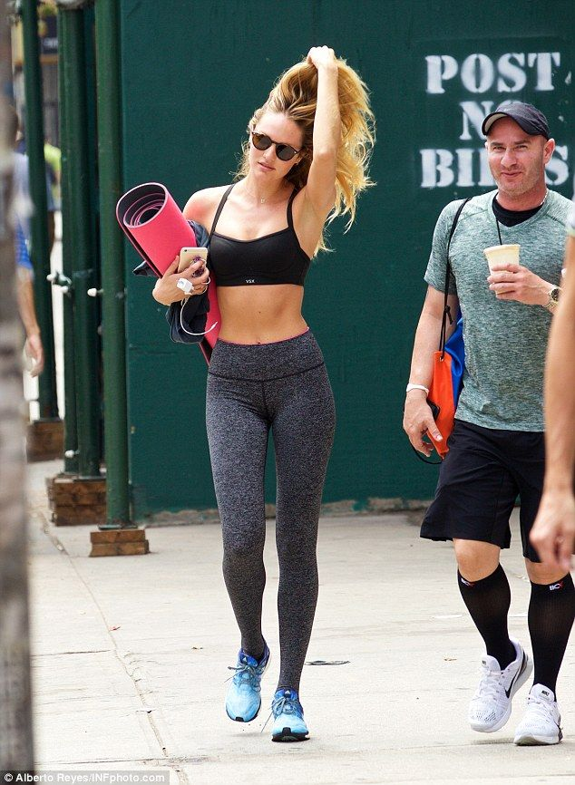 cae416cf568b9 Back at it: Last Wednesday, the Vogue cover star wore a black  spaghetti-strap sports bra and salt and pepper leggings as she carried a  yoga mat after a ...