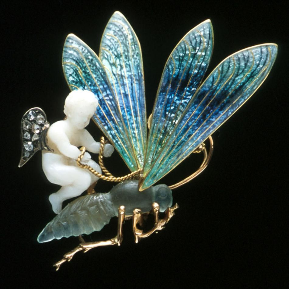 An angel skin coral, enamel, chalcedony and diamond-set brooch after Julien Duval comprising a carved angel skin coral putti with rose diamo...