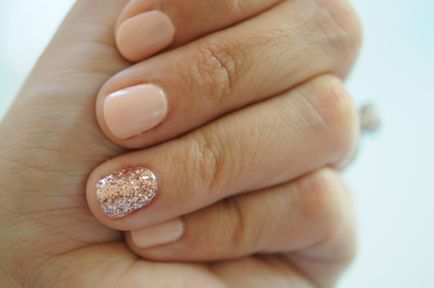 nude nails, one sparkly.