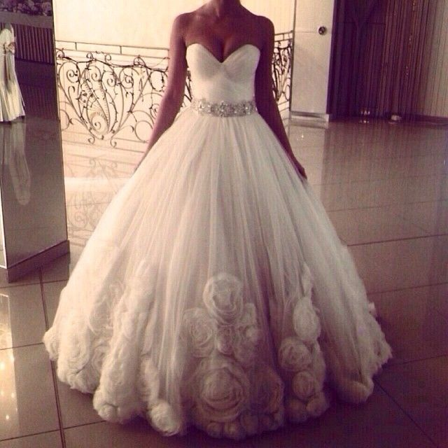 The top shows a little too much cleavage for my taste but for Ariana grande wedding dress