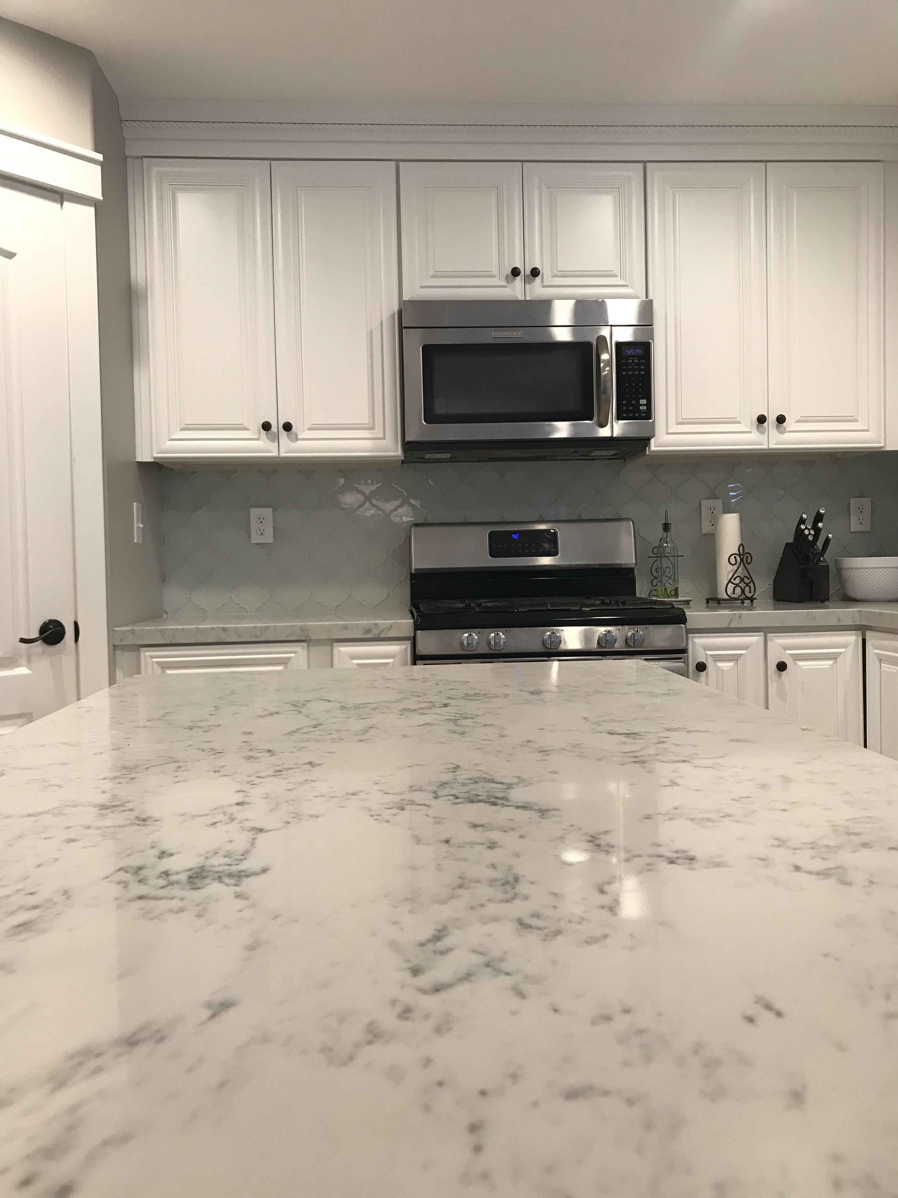 Carrara quartzite white cabinets elysium arabesque glass tiles