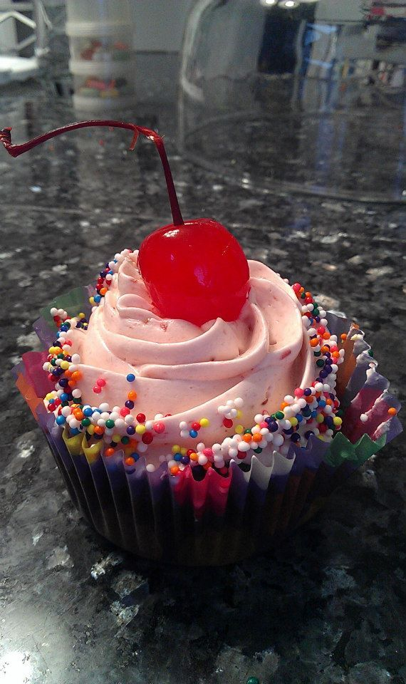 - Vanilla cucpakes with cherry frosting, topped with a cherry and sprinkles