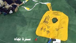 """Image copyright                  Egyptian Military/Reuters                  Image caption                     Debris from the plane has been recovered from the sea north of the Egyptian coast   Search teams looking for the flight recorders of the EgyptAir plane have picked up a radio signal from an emergency locator transmitter, Egyptian investigators say.  This could help to narrow the search area for the """"black boxes"""" to a 5km (3 mile) radius"""