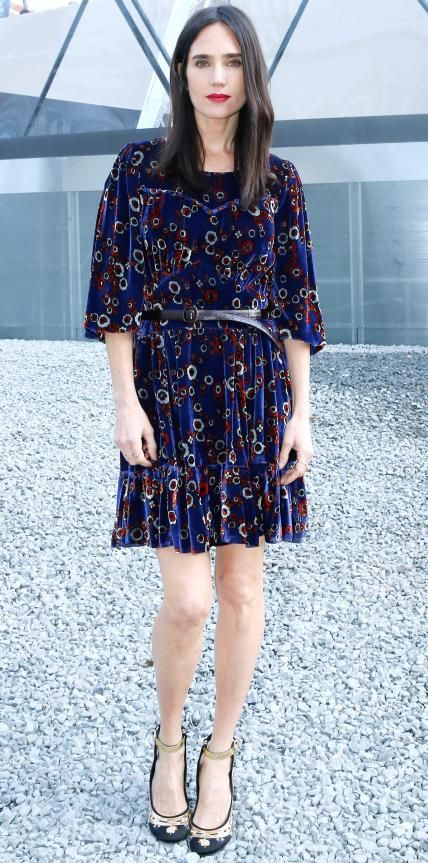 Look of the Day - March 11, 2015 - Jennifer Connelly struck a spring-ready chord at the Louis Vuitton fall/winter 2015 show in a printed velvet Louis Vuitton flouncy frock that she styled with a skinny belt at the waist and printed ankle-strap pumps.  from #InStyle
