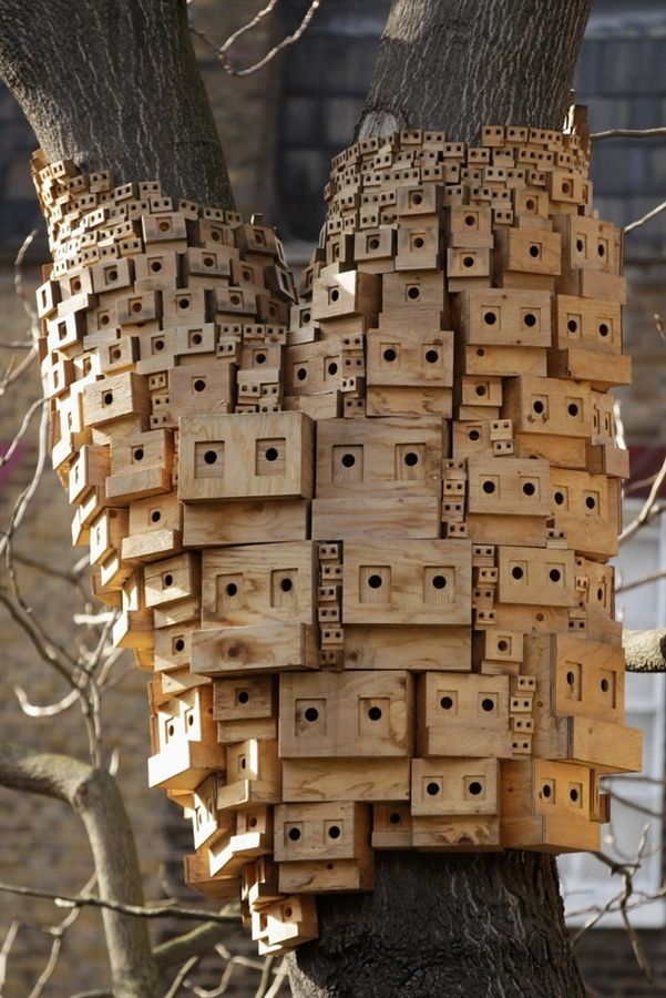 An installation consisting of a series of bird boxes is displayed in a tree in Duncan Terrace Gardens in Islington on March 24, 2011 in London, England. These boxes by artists Bruce Gilchrist and Jo Joelson of 'London Fieldworks', were designed to reflect the architecture of the Georgian terraces and flats that surround the park in the community gardens.
