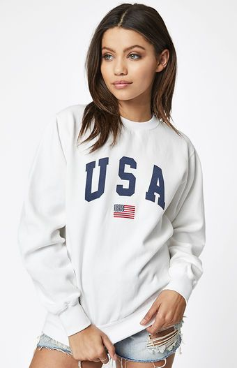 a29336e5a0c1 Keep cozy in this Erica USA Sweatshirt by John Galt. This pullover  sweatshirt features long sleeves