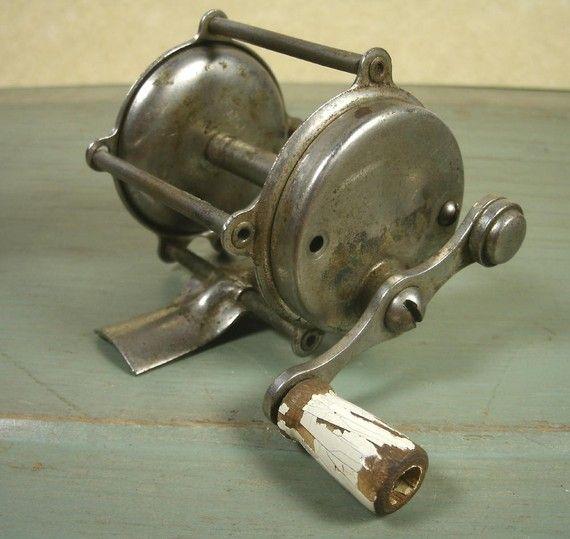Vintage Fishing Reel Under A Bell Jar