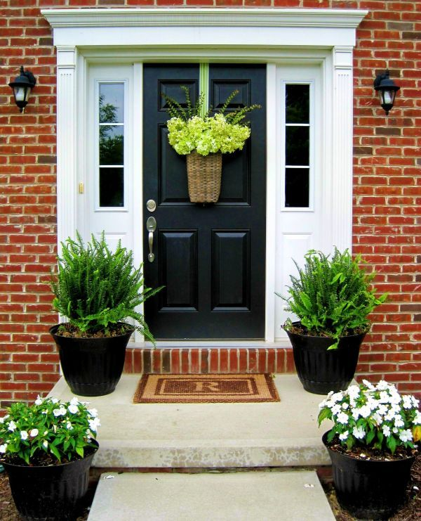 Potted Plants And Hanging Arrangements Are A Nice Way Of Decorating A Black  Door
