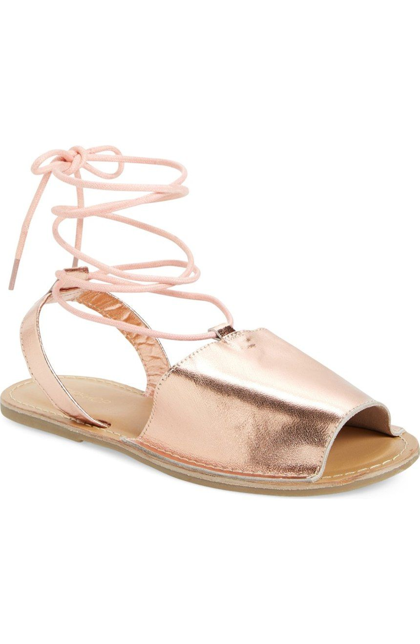 Obsessing over this lace-up sandal by Topshop in a shiny rose gold color.