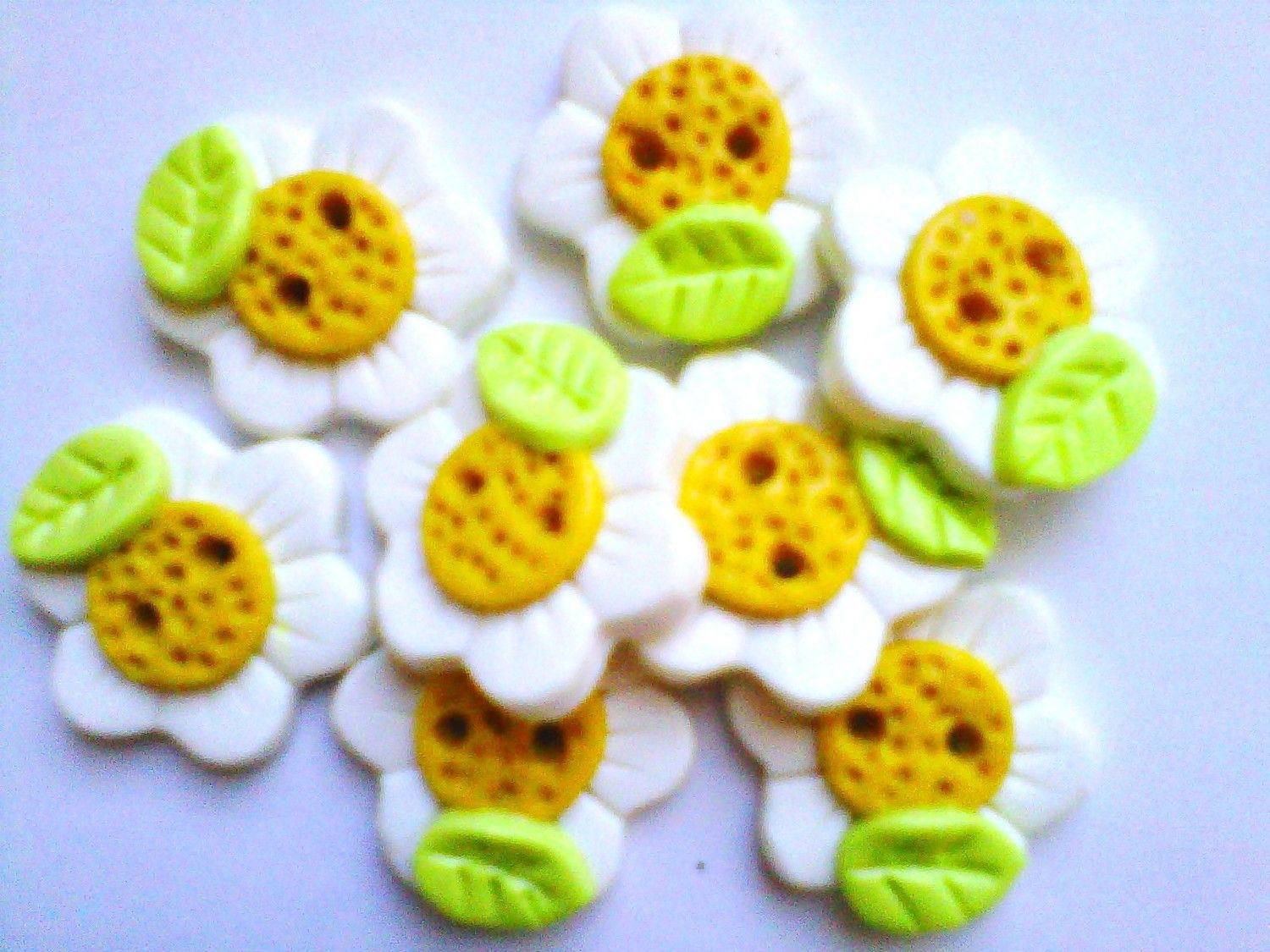 Button Daisies handmade polymer clay buttons  ( 8 ). $8.50, via Etsy.