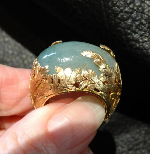 dd4dcdbcae1a Natural color greenish blue jadeite cabochon gemstone is mounted in a  handmade one-of-a-kind setting of 22K gold. Exceptional goldsmithing forms  lacy leaves ...