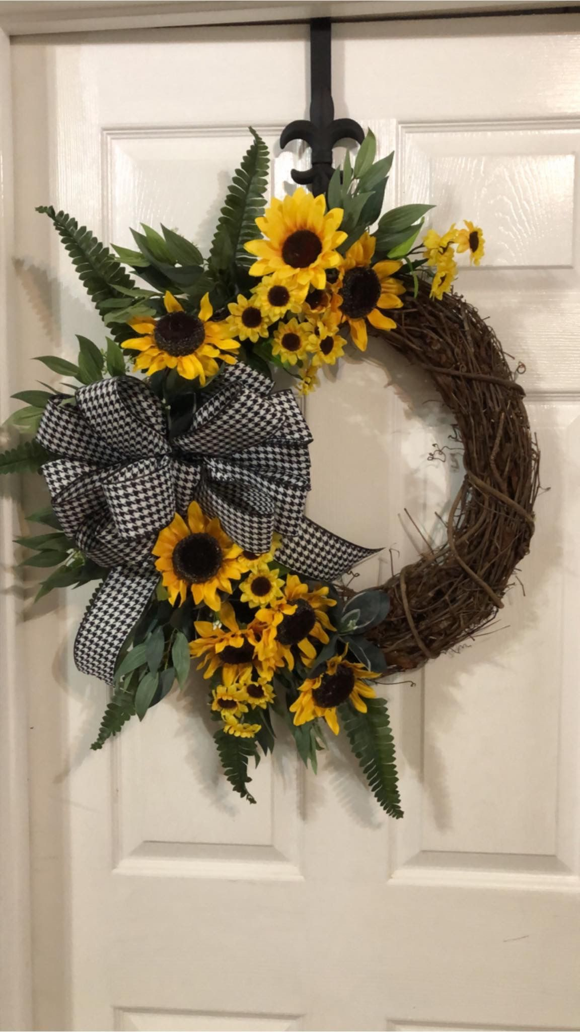 """Photo of Sunflower wreath on a 18"""" grapevine wreath with a beautiful black and white bo…"""
