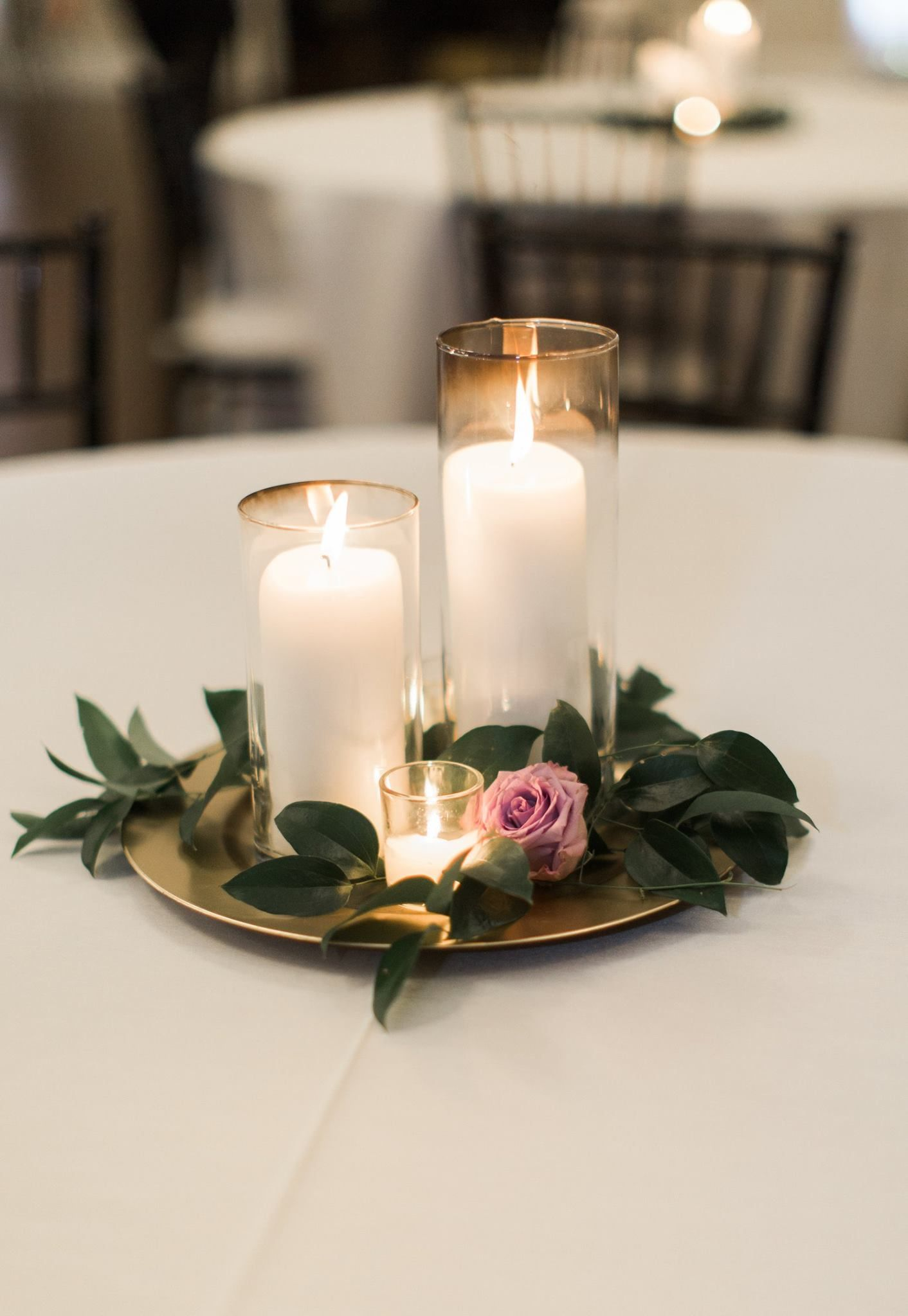 Candle wedding centerpiece purple and greenery centerpiece for Simple wedding decorations for reception