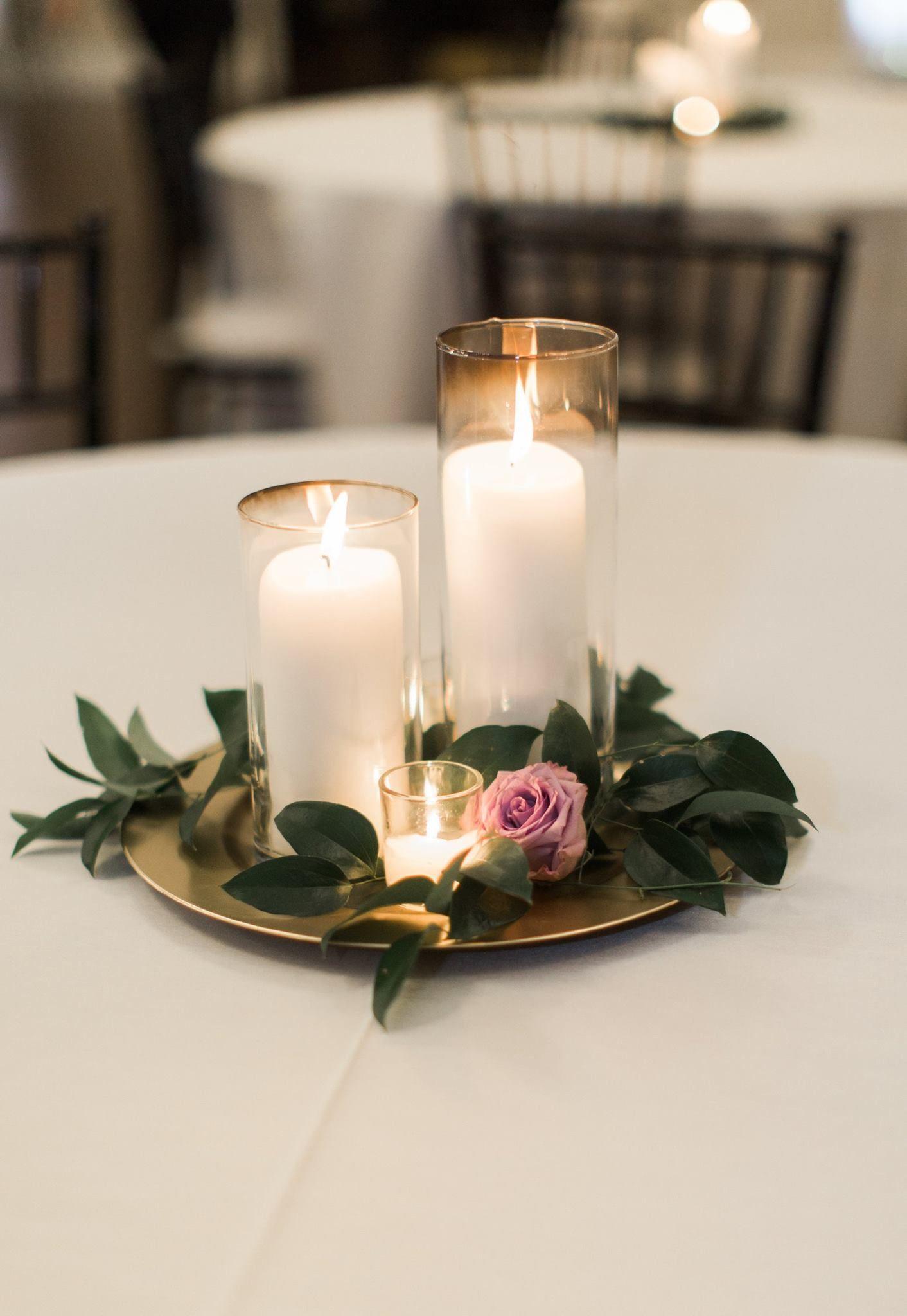 candle wedding centerpiece purple and greenery centerpiece