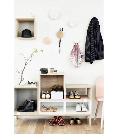 @Alex Leichtman M What Wear - Everything In Its Place If you tend to rotate between a few pairs of shoes, keep them in an open bookcase display by the door, so you can quickly grab them on your way out.  Tip: Avoid clutter by assigning a maximum of two pairs to each cubbyhole.