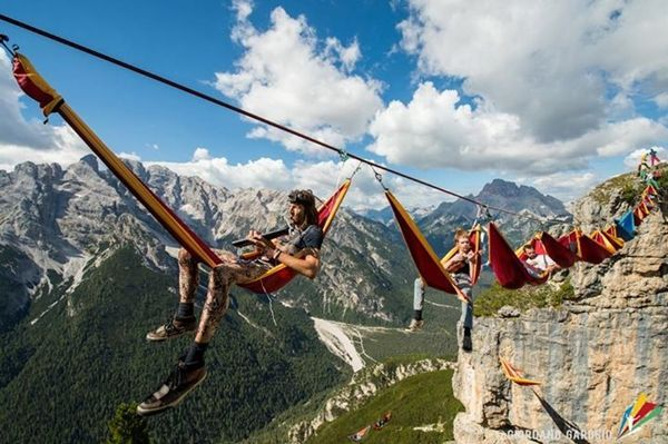 Daredevil Tightrope Gathering :: Italy | Held at Monte Piana this year, which is located in north-eastern Italy, the tightrope gathering allowed like-minded individuals to enjoy a breathtaking panoramic view of the Italian Alps as they hung precariously from a bright red rope.