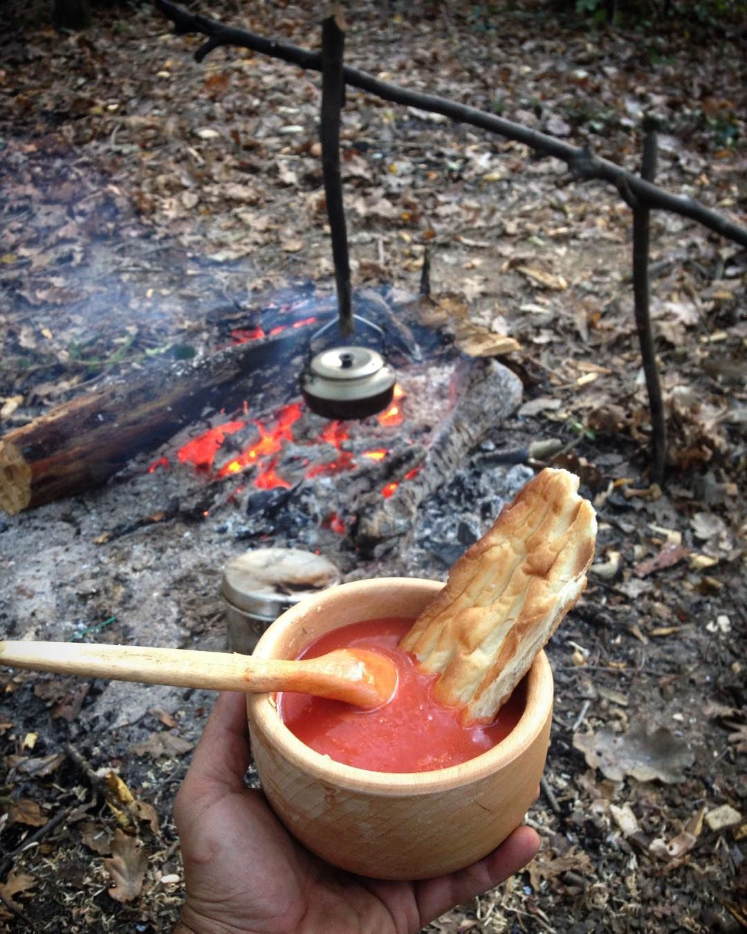 Soup and bread by the campfire