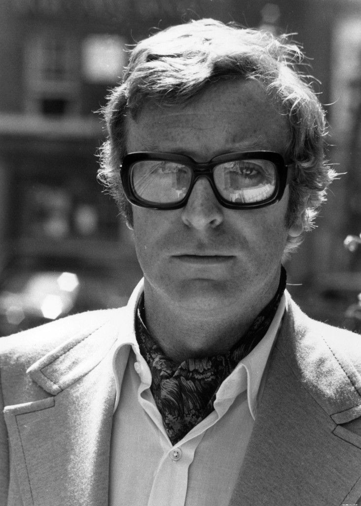 Michael Caine is looking fresh to death in those glasses and ascot. I didn't realize he was a ginger boy.