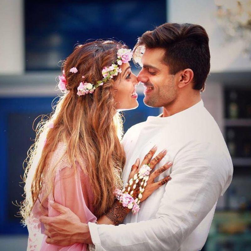 Bipasha Basu and Karan Singh Grover at their Sangeet and Mehendi -  Anushree Reddy -Lehenga - floral jewellery -bollywood - wedding - bride - flower crown