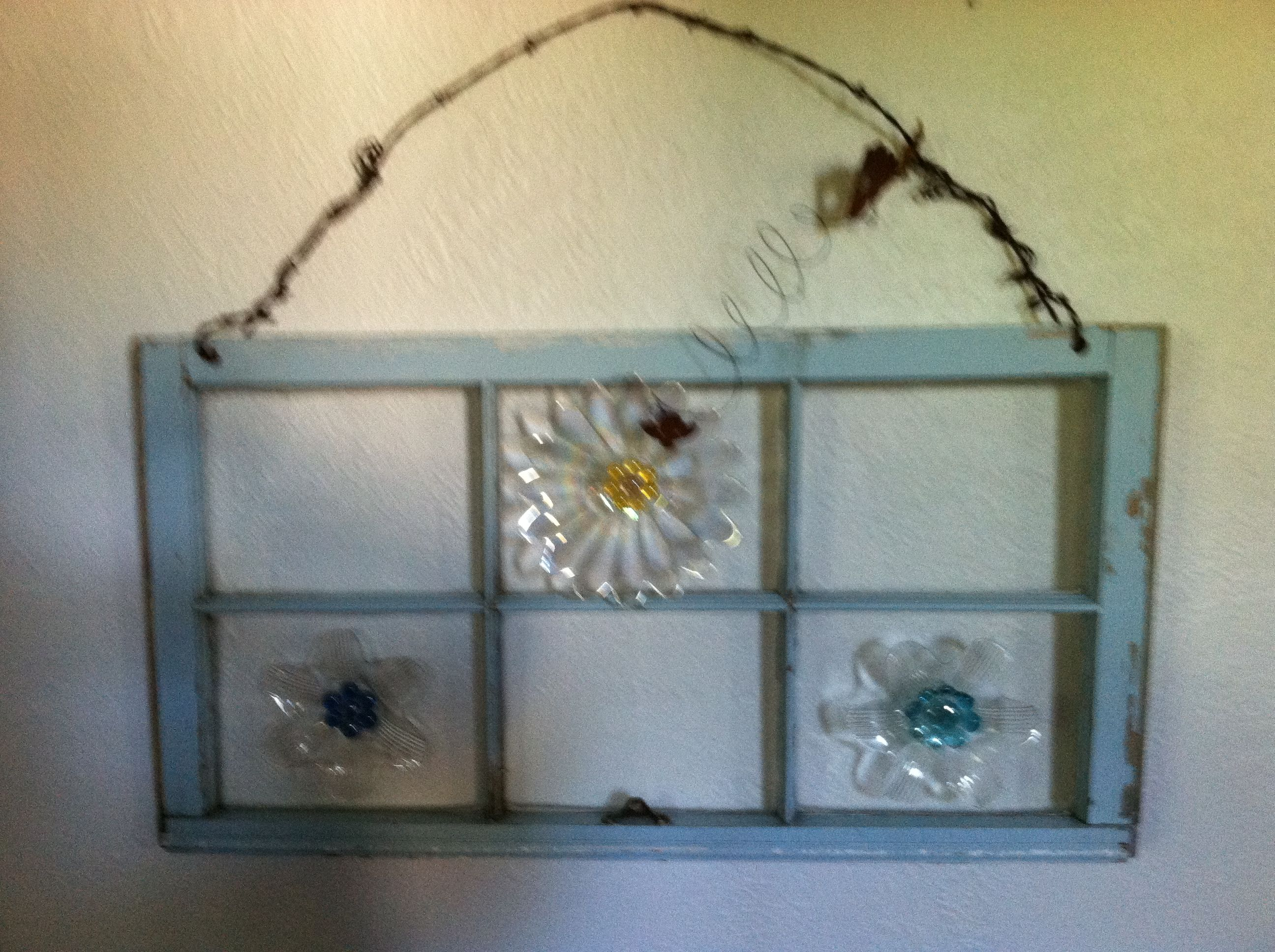 Old Window with thrift store flower plates, glass pebbles and barbed ...