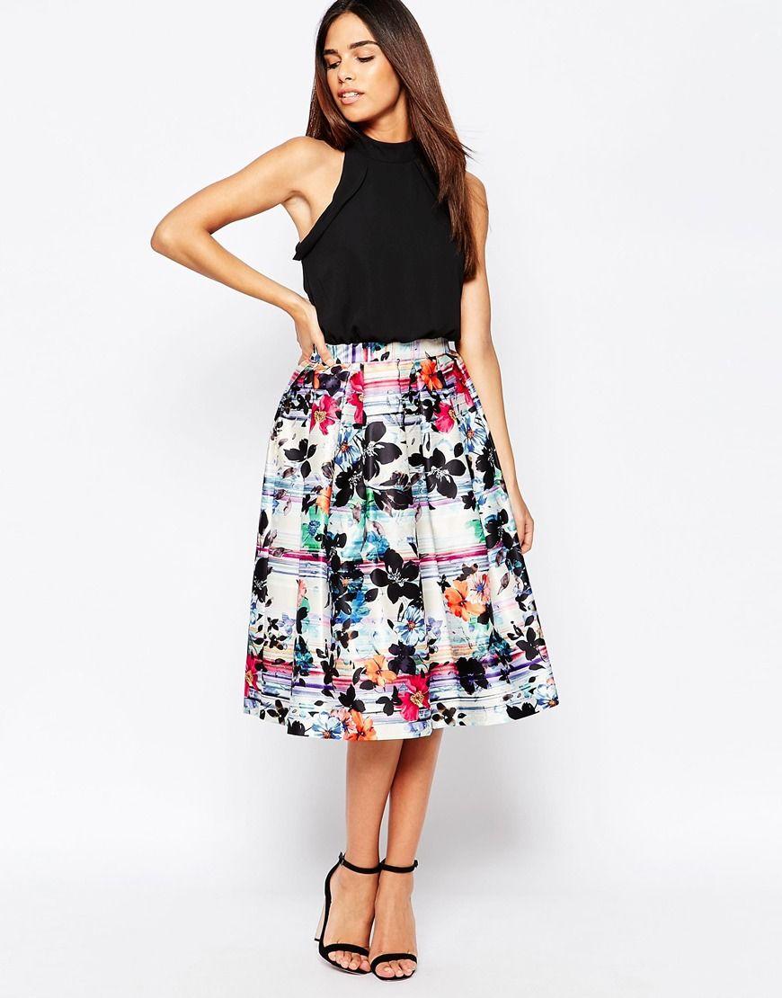 Vestido a media pierna con estampado floral a rayas de Warehouse ...
