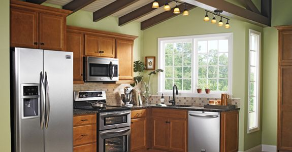 Maple Cabinets With Light Sage Green Paint On The Walls Black Granite Pretty Lighting And Stai Green Kitchen Walls Sage Green Kitchen Walls Kitchen Cabinets