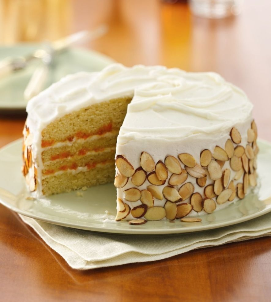 The combination of tasty fruit and toasted almonds couldn't get any sweeter than in this bakery-style layer cake that's filled with juicy apricot preserves. You can also use 9-inch cake pans--just increase bake time to 25-30 minutes.