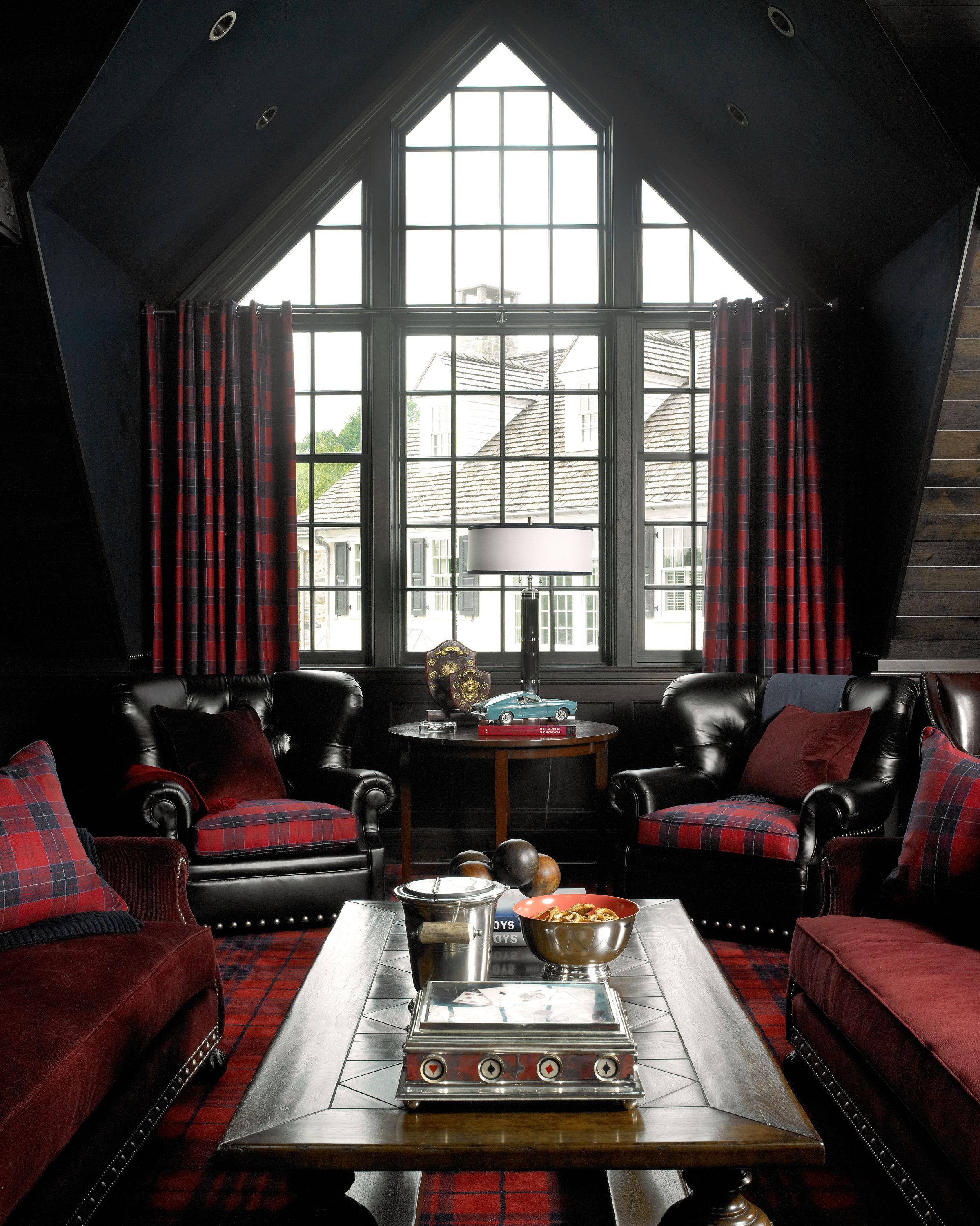 Red & Black Lounge or Living Area Masculine with Dark Woods and