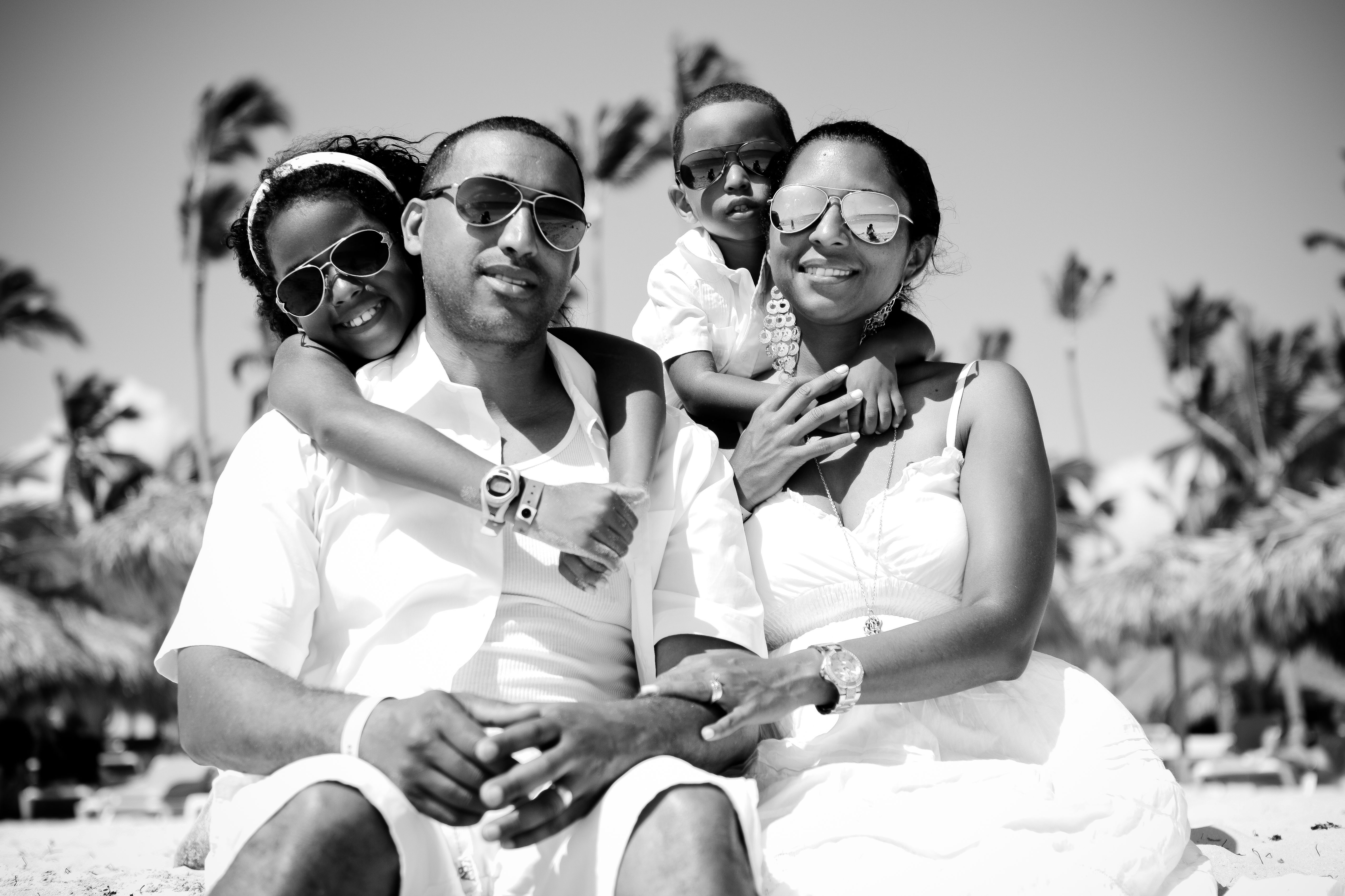 Beach family portrait wearing all white and sunglasses all white family portraits sunglasses