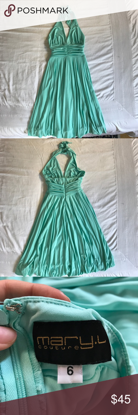 Beautiful teal halter flowy dress Mary L Couture Beautiful teal halter flowy dress. Perfect condition. Worn once Mary L Couture Dresses Midi