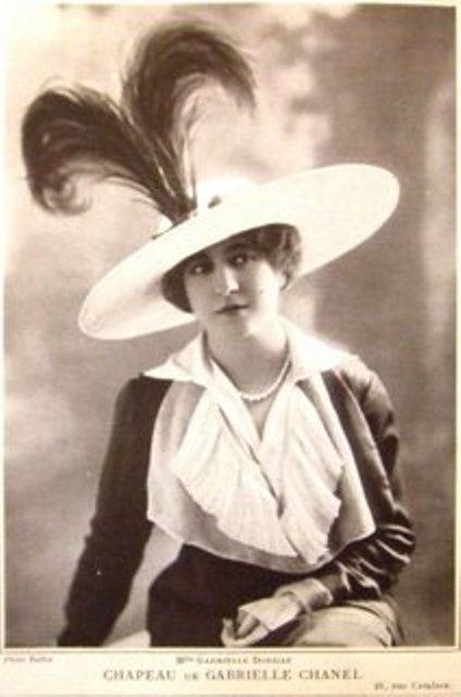 """Gabrielle Coco Chanel wearing one of her hats in 1912 """"Costume jewelry is  not made to give women an aura of wealth 2c587948c1b5"""