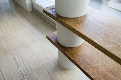 Amsterdam - a workplace made in an amsterdam apartment features a heavy oak wooden shelve clamped between two load bearing columns. With incredible views over the IJ in Amsterdam this workplace is truely amazing! //