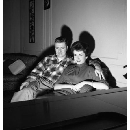 Young couple watching television Canvas Art - (18 x 24)