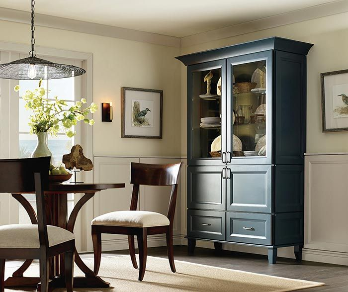 This Pretty Space Features A Dining Room Storage Cabinet In Maple