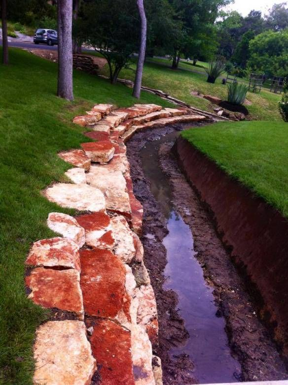 Removing The Rocks From A Residential Drainage Ditch Drainage Ditch Drainage The Rock