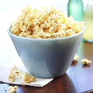 This cheese topped popcorn is a fun snack for kids. Make it for a party and watch them eat it up.