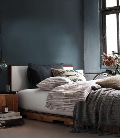 This is such a man's bedroom! Love the grey walls and the understated bed linen