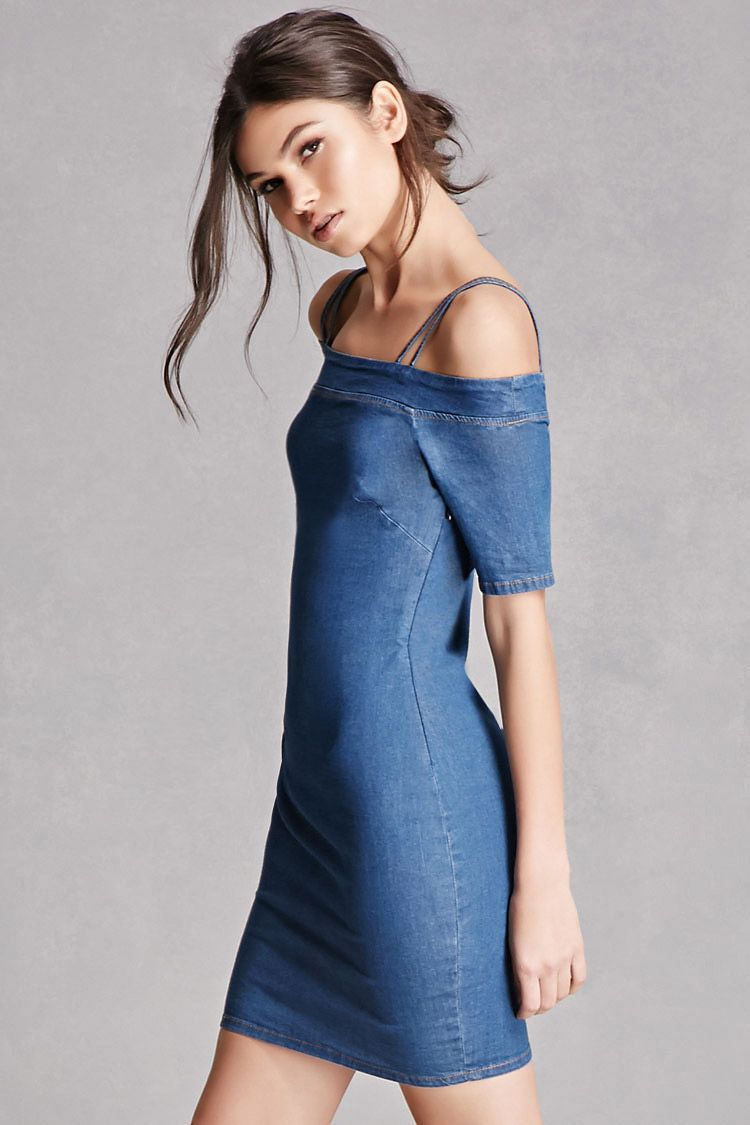 89b7e571b0 A stretch denim mini dress featuring open shoulders